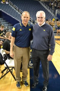 UM Men's Basketball Coach John Beilein and 2014 Grand Marshall Mike Lantry take a timeout at the U-M Army v Navy Wheelchair Basketball Game. Alumus and Vietnam veteran Lantry was an All-Big Ten standout under Coach Bo Schembechler before signing with the Dallas Cowboys. Photo by Phil Larson