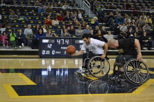 Navy makes a long run down the court flanked by Army defense at the 2014 Army v Navy Wheelchair Basketball Game. Photo by Phil Larson